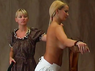 Blonde is getting her back spanked so hard