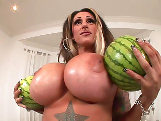 Tattooed babe with big melons is fucking in her tight holes and giving an awesome titjob