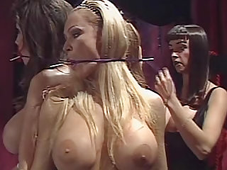 This naked slave pornstars with big tits are getting tied up with a rope by their mistress wearing a latex outfit in this femdom video in the dungeon.
