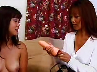 Asian milfs Sarya Ling and Teanna Kai are banging their wet holes with sex toys in this lesbian video.