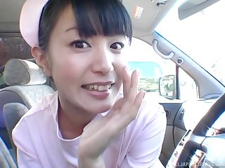 Hot Japanese nurse sucks dick and fucks him in the car
