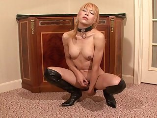 Tranny goddess in a collar and boots jerking off solo
