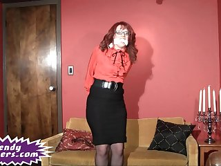 Tranny bound in a blouse and skirt and struggling against the ropes