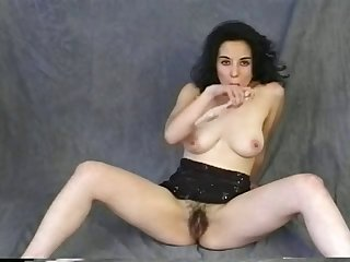 Hairy babe pushes a dildo into her cunt nice and slow