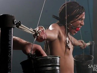 Hot young slut in brutal bondage suffering.