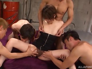 Four men fondle and fuck the slender Japanese girl