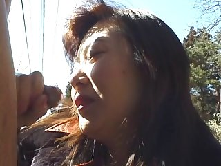 Splendid Japanese brunette sucks the dick under the warm sun