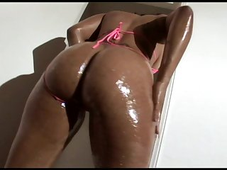 Fine fat oiled ass on a sexy black girl taking big dick
