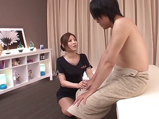 The hotel masseuse rubs him down and gives him a happy ending