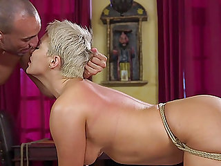 Short haired blonde MILF Ryan Keely spreads her legs in bondage