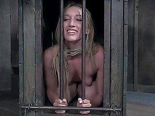 Kel Bowie let out of her cage for a spanking bondage session