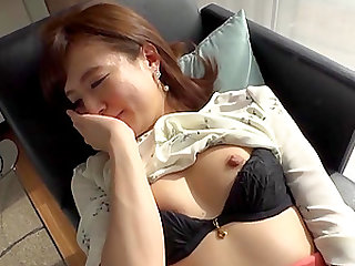 sexy asian brunette gets fucked by a stiff penis while she moans