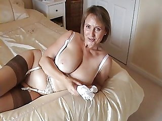 British Milf wanks his cock with her panties (Hand job POV)