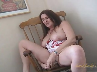 Big mature tits are marvelous as she plays solo