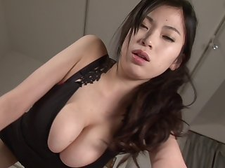 Delicious Asian babe with massive melons rubs against a dude's crotch