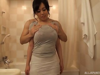 Big sexy natural Japanese tits wrapped around his dick