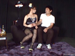 Pantyhose footjob from the sultry Japanese girl gets him going
