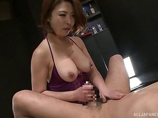 Busty Japanese woman dildoes a guy's ass and sits on his face