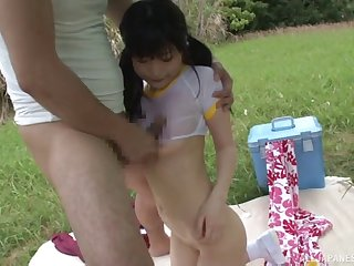 Oiled up Asian teen is turned on and fucking outdoors