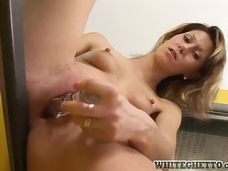 Amanda Vamp plays with a dildo in the kitchen and shows her gaping pussy